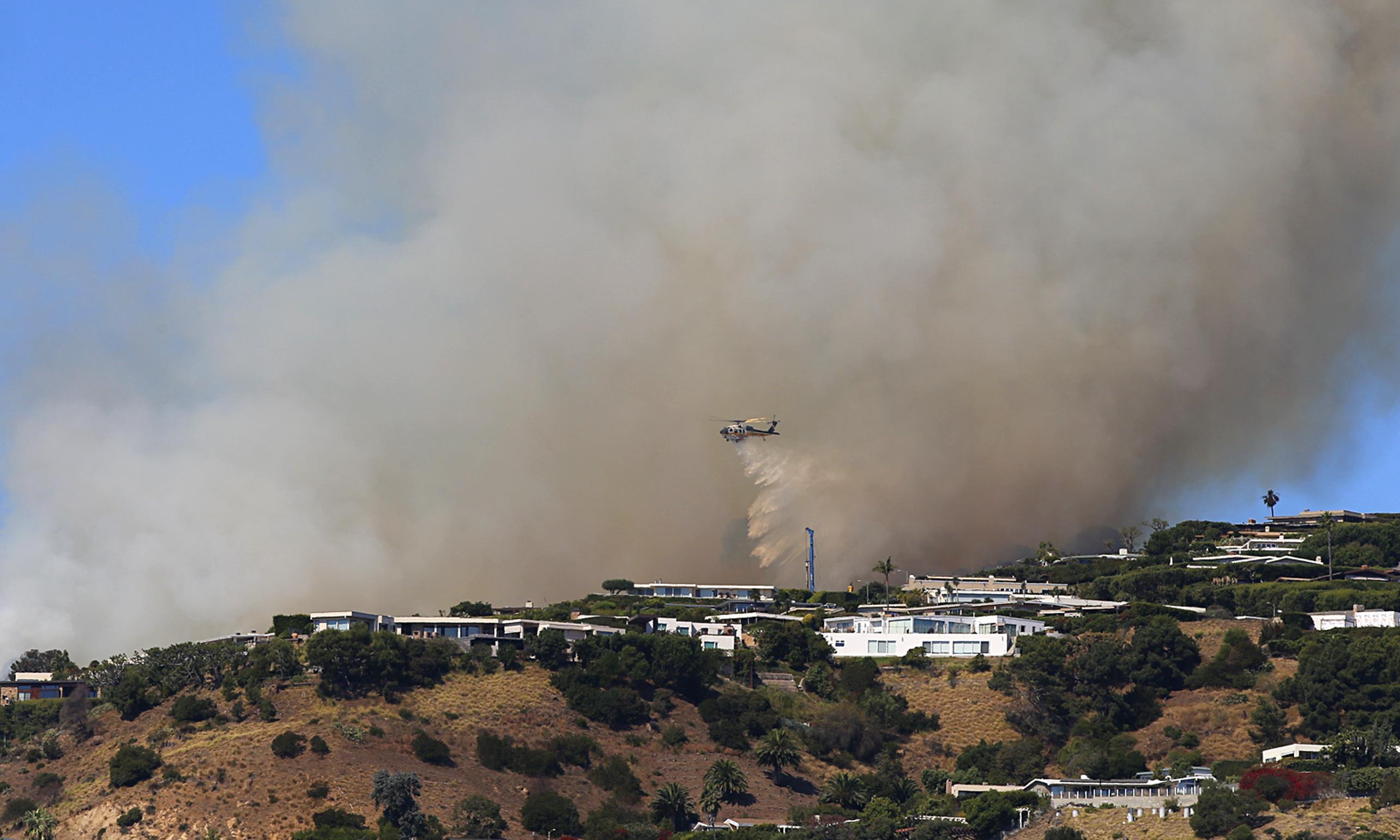 Wildfire burns Los Angeles area hillside, threatening multimillion-dollar homes