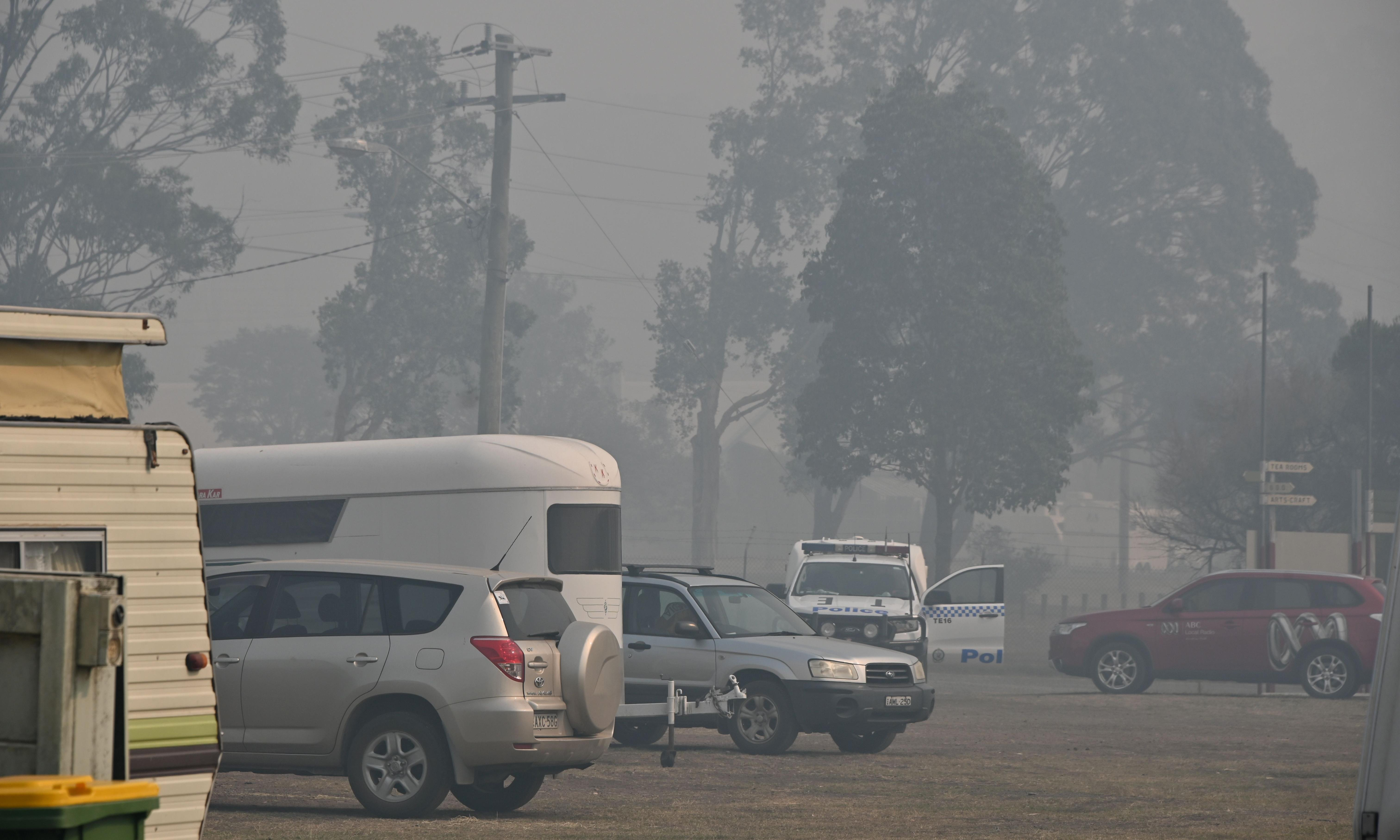 Hazardous air quality warning as smoke from bushfires spreads across NSW and Queensland