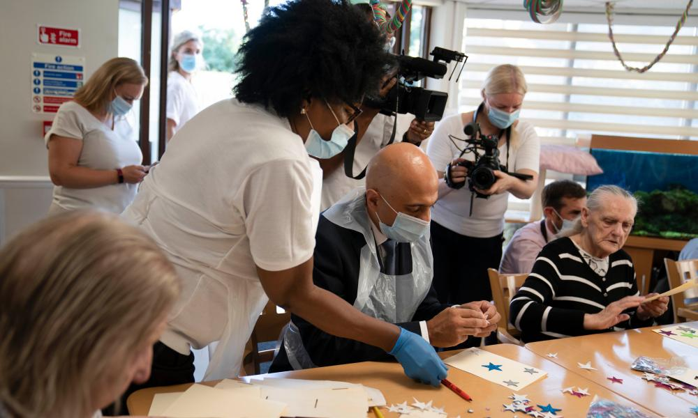 Sajid Javid during a visit to a care home