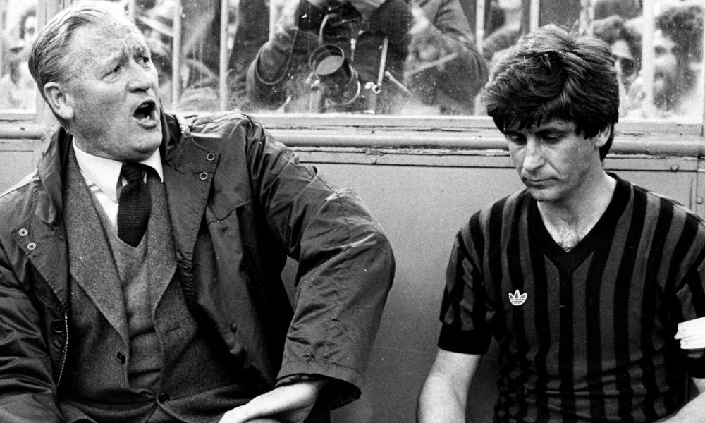 Milan's coach Nils Liedholm (left) and his captain Gianni Rivera on the bench at San Siro.