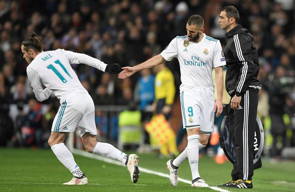 Bale on for Benzema.