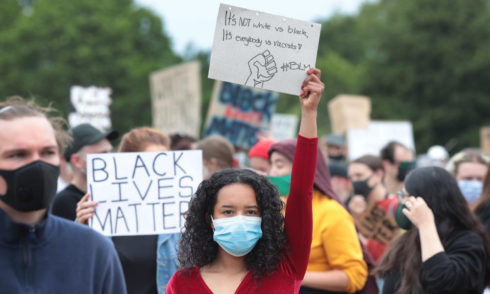 Protestors wear protective face masks as they gather in London's Hyde Park in solidarity with the Black Lives Matter movement.