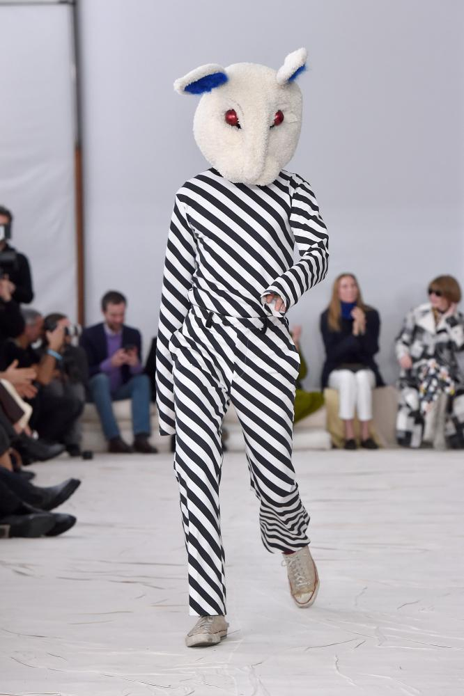 Marni's designer, Francesco Risso, took his post-show bow in a menacing Donnie Darko outfit.