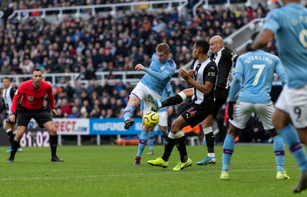 Kevin De Bruyne scores Manchester City's second goal at Newcastle.