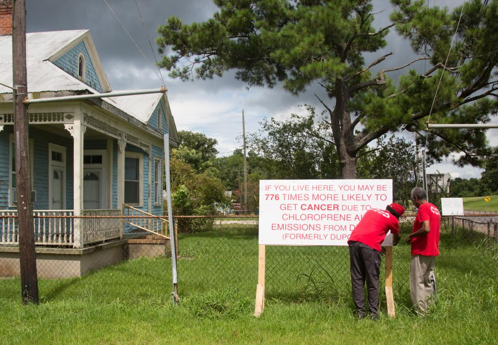 Concerned Citizens of St John the Baptist putting up signs in Reserve.