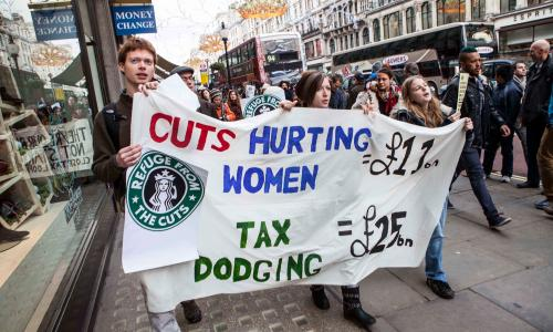 Protesters marching down Regent's Street London and occupying and protesting against Starbucks coorporate tax policies. The protest was directed by UK Uncut which campaugns for coorporate tax compliance