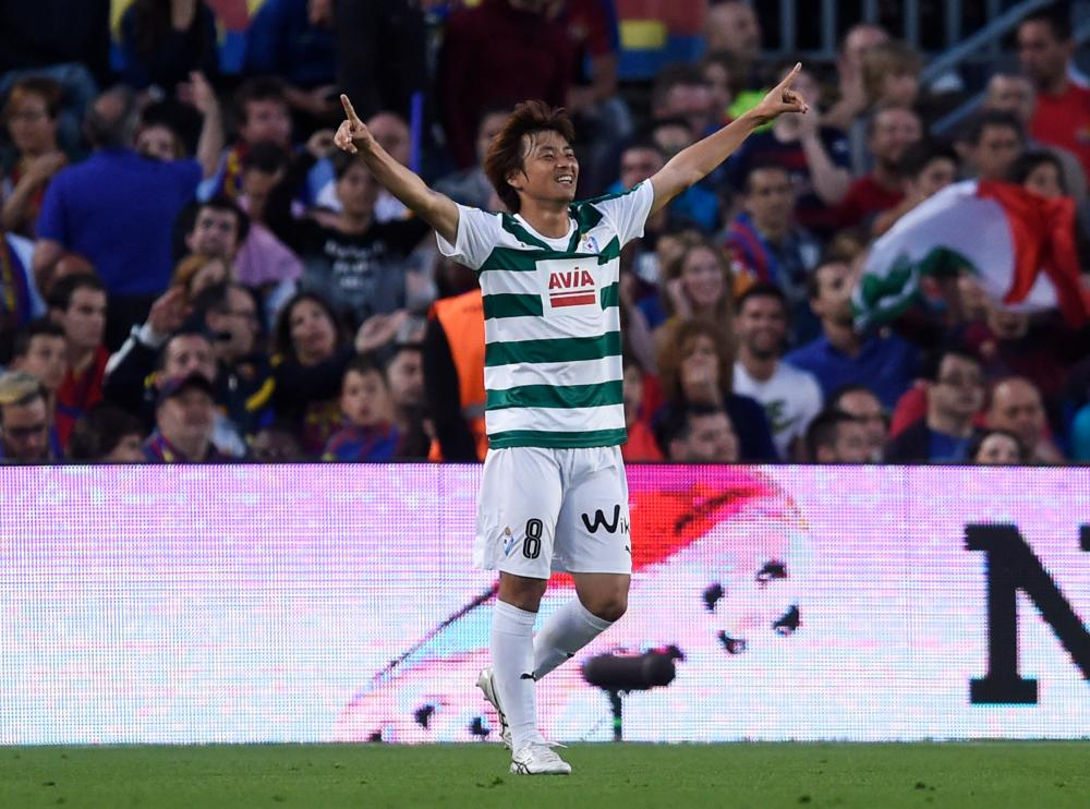 Eibar's Takashi Inui celebrates his goal at the Nou Camp