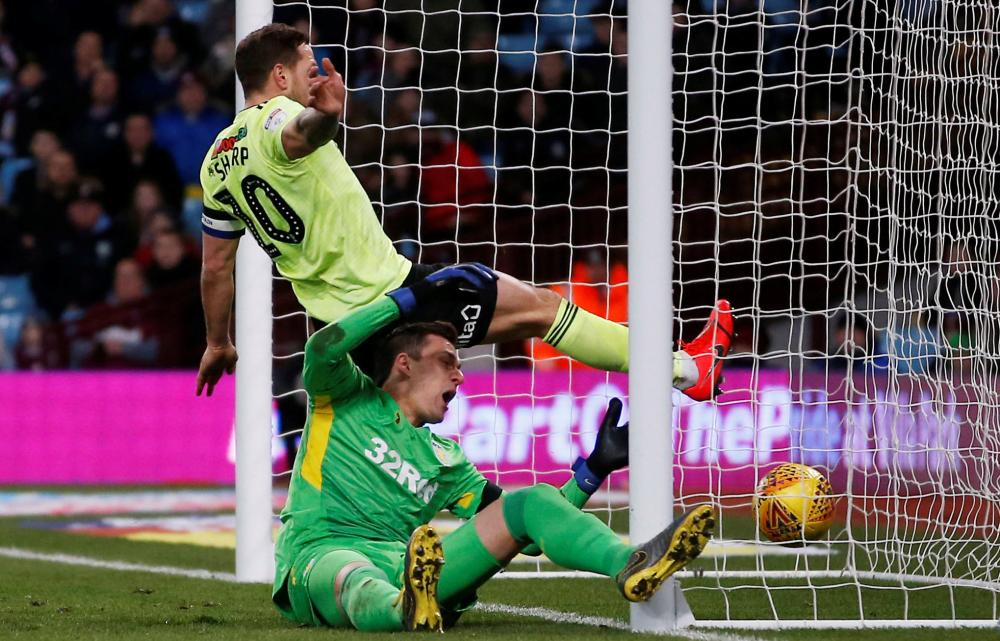 Billy Sharp scores his second goal of the match after appearing to kick the ball out of Lovre Kalinic's hands.