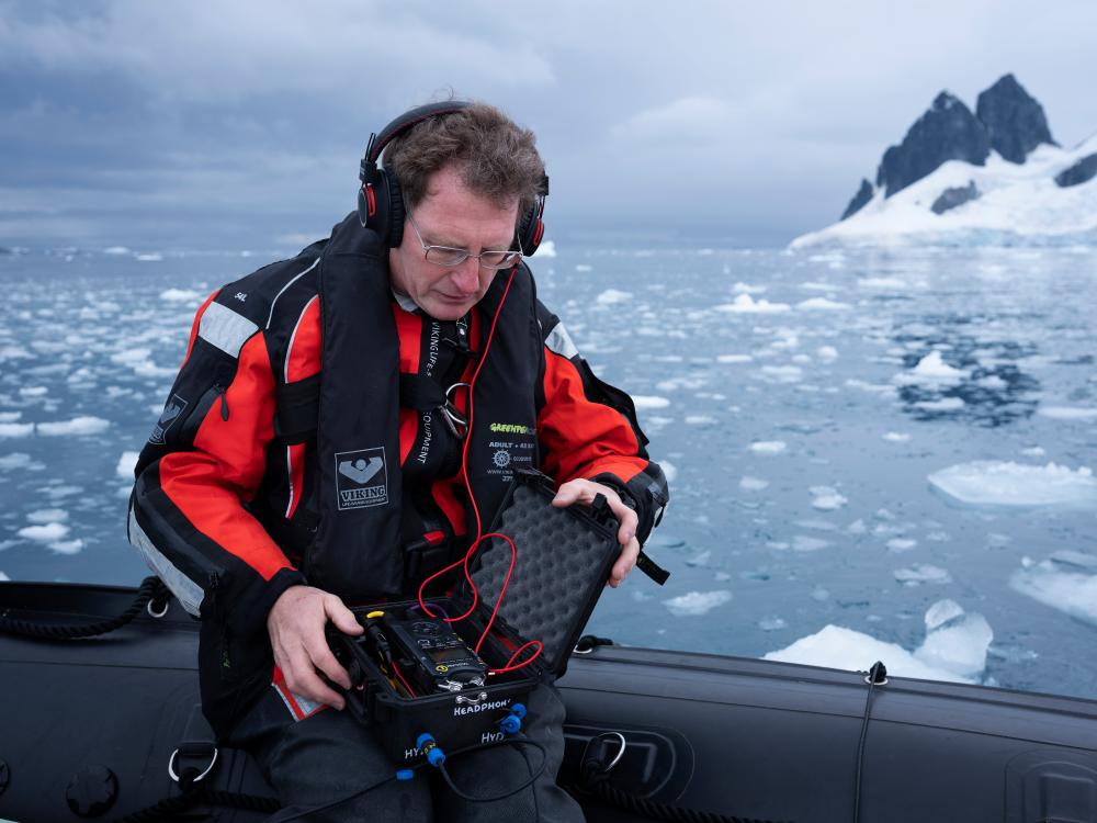 Marine acoustics specialist Tim Lewis in the Errera Channel in Antarctica.
