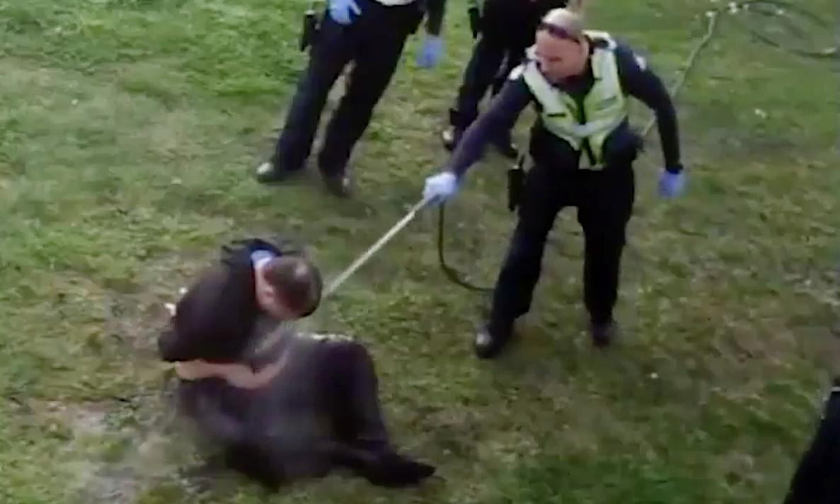 Pensioner 'consented' to high-pressure hose in face, accused officer claims