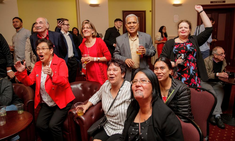 Labour supporters cheer as they watch the results come in during the New Zealand Labour party election night event in Auckland