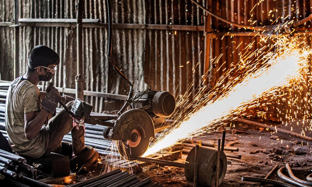 A welder in a factory in Nepal. Migrant workers, particularly those in the informal economy, are at greater risk of exploitation during the Covid-19 pandemic.