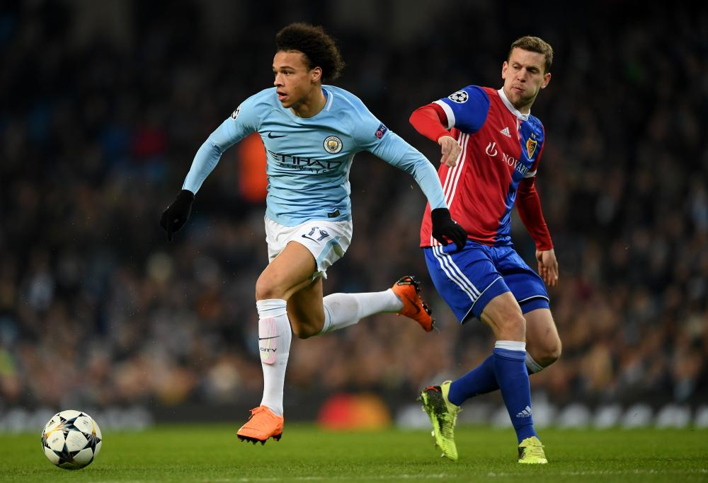 Leroy Sane of Manchester City skips past the tackle of Basel's Fabian Frei and then puts the burners on.