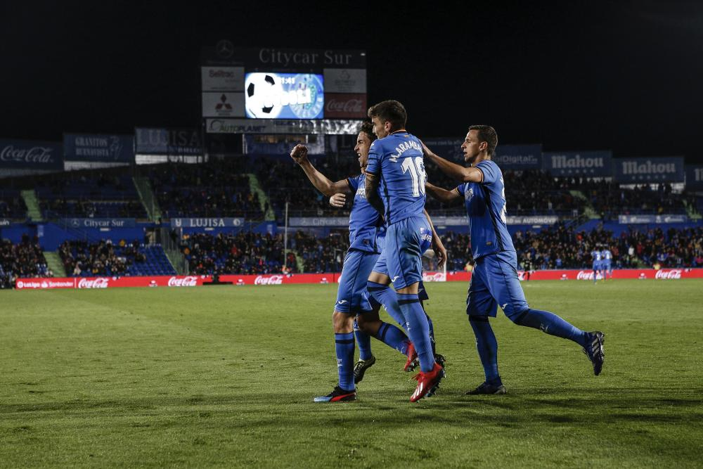 Getafe celebrate against Huesca.