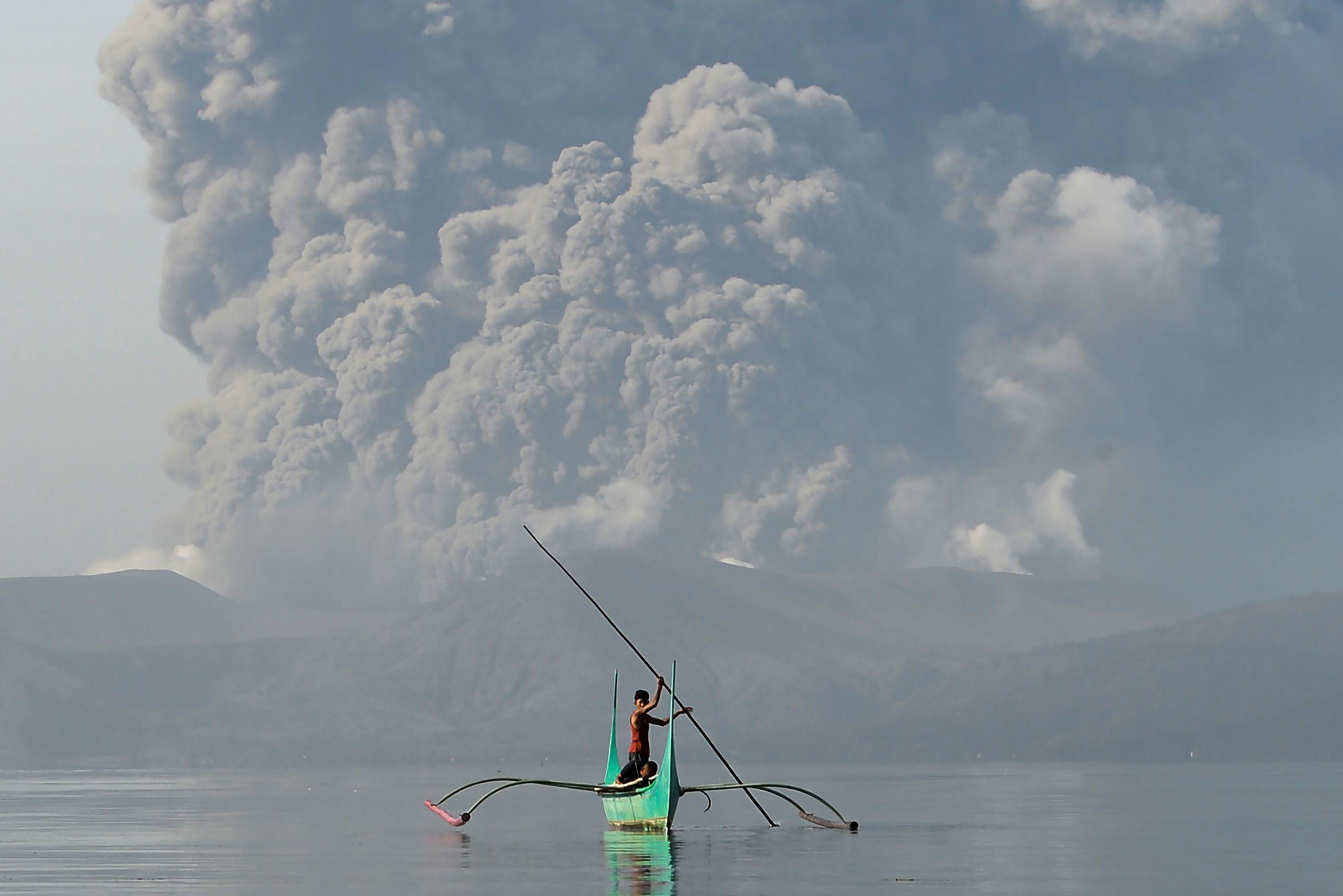 Taal volcano eruption: Philippines alert level raised as thousands flee ash clouds