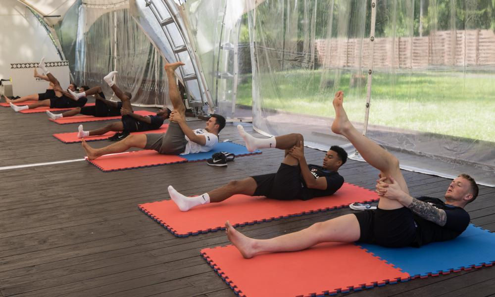 Raheem Sterling, Harry Maguire, Jesse Lingard and Jordan Pickford, seen here stretching at England's hotel on Thursday, will be in their prime at the next World Cup.