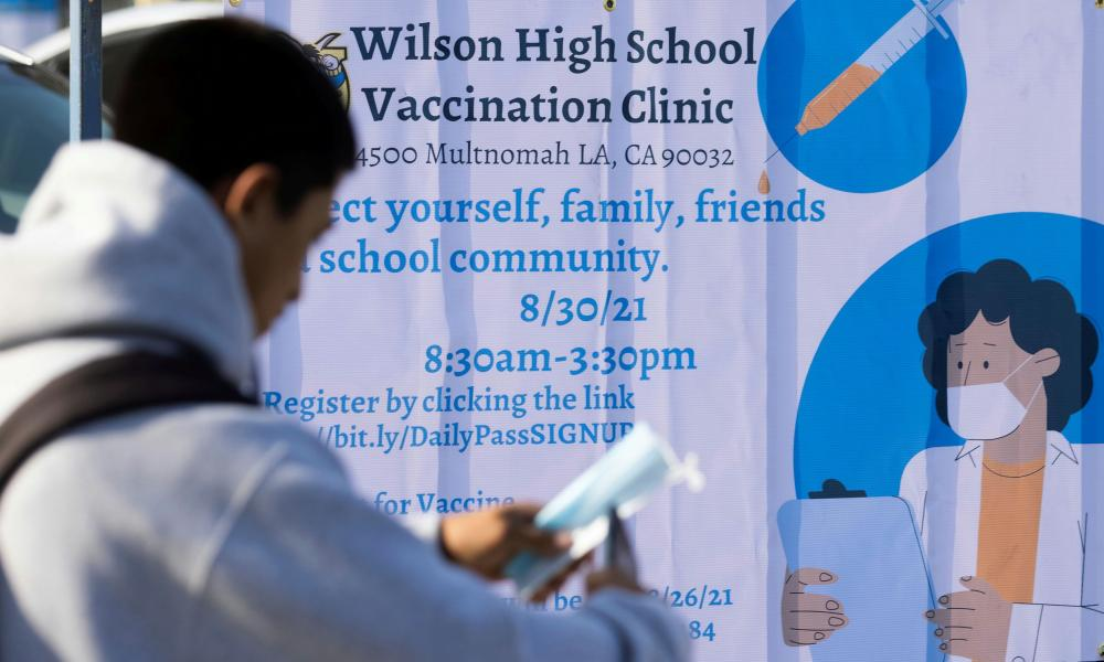 A mobile vaccination team visits a school campus in Los Angeles last month.