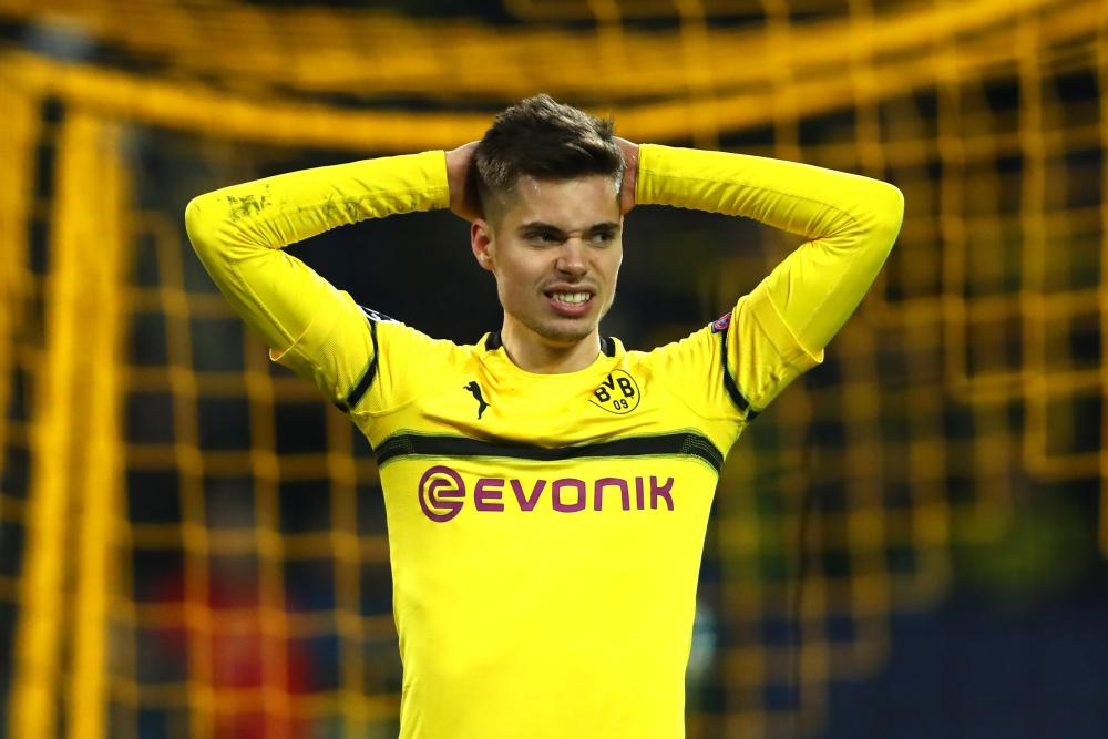 Julian Weigl of Borussia Dortmund reacts to a missed chance.