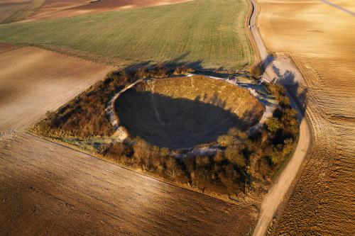 The 100-metre-wide Lochnagar Crater on the Somme, created by a huge mine placed under a German fortification by the Royal Engineers in 1916. The photograph by Mike Sheil will be among those on show at an exhibition marking the 100th anniversary of the Battle of the Somme to be held outside Guildhall in London from 1 June to 3 July<br>