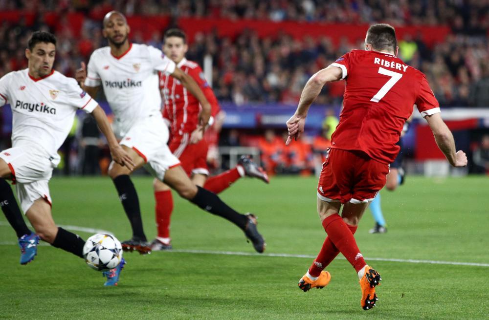 Franck Ribery's shot is deflected off Navas.