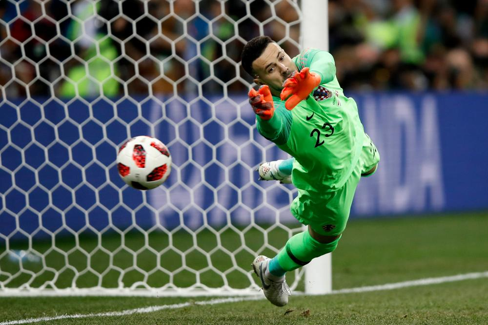 Subasic saves the first penalty from Eriksen.