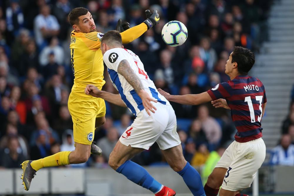 April 27: Brighton's keeper Matthew Ryan is challenged by Newcastle's Yoshinori Muto.