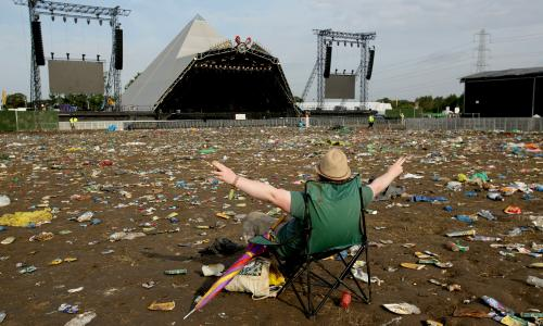 The litter strewn around the Pyramid Stage area as the clean up operation begins on site, at the Glastonbury Festival, at Worthy Farm in Somerset.  PRESS ASSOCIATION Photo. Picture date: Monday June 30, 2014. Photo credit should read: Yui Mok/PA Wire