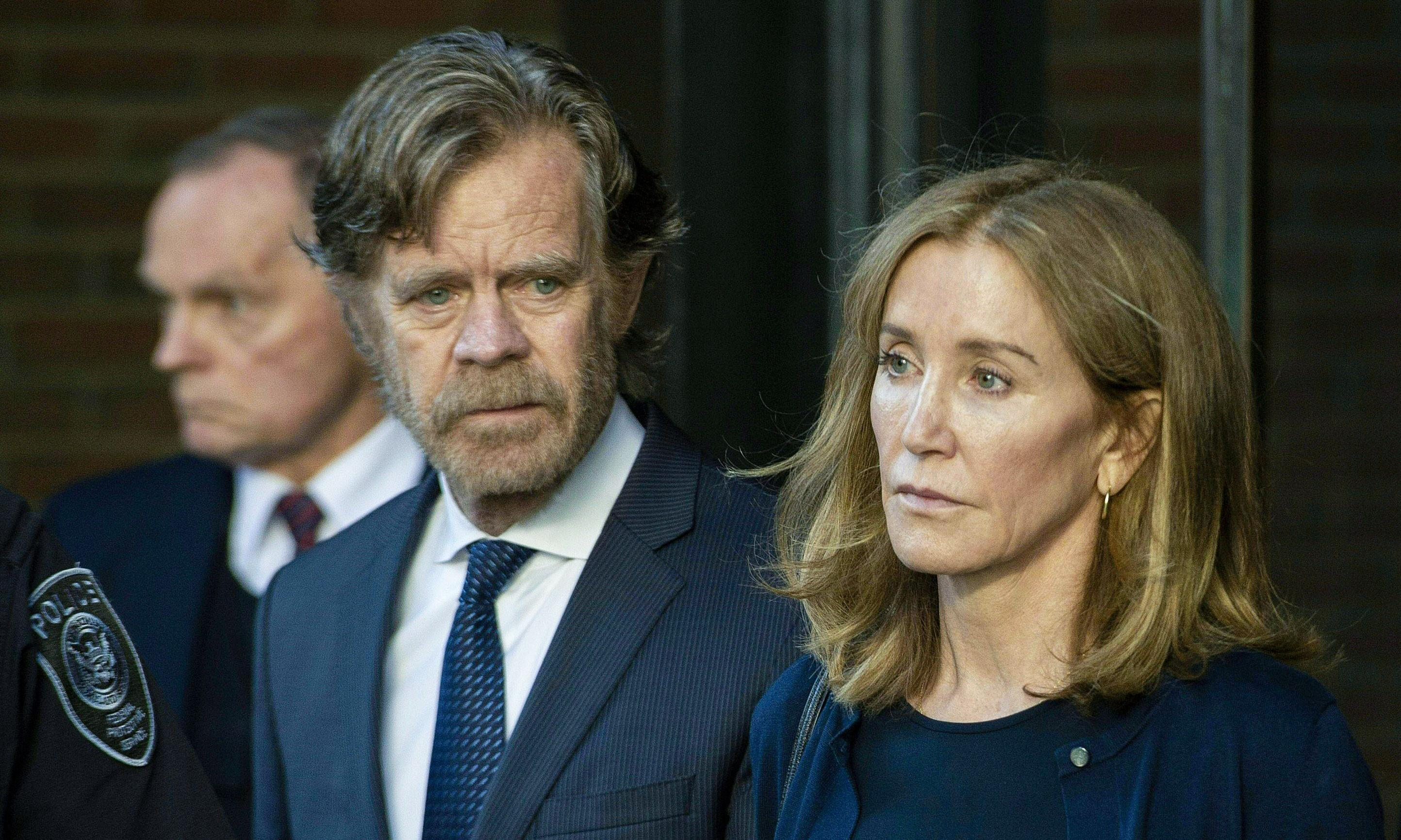 Felicity Huffman reports to prison to serve 14-day sentence in college scandal