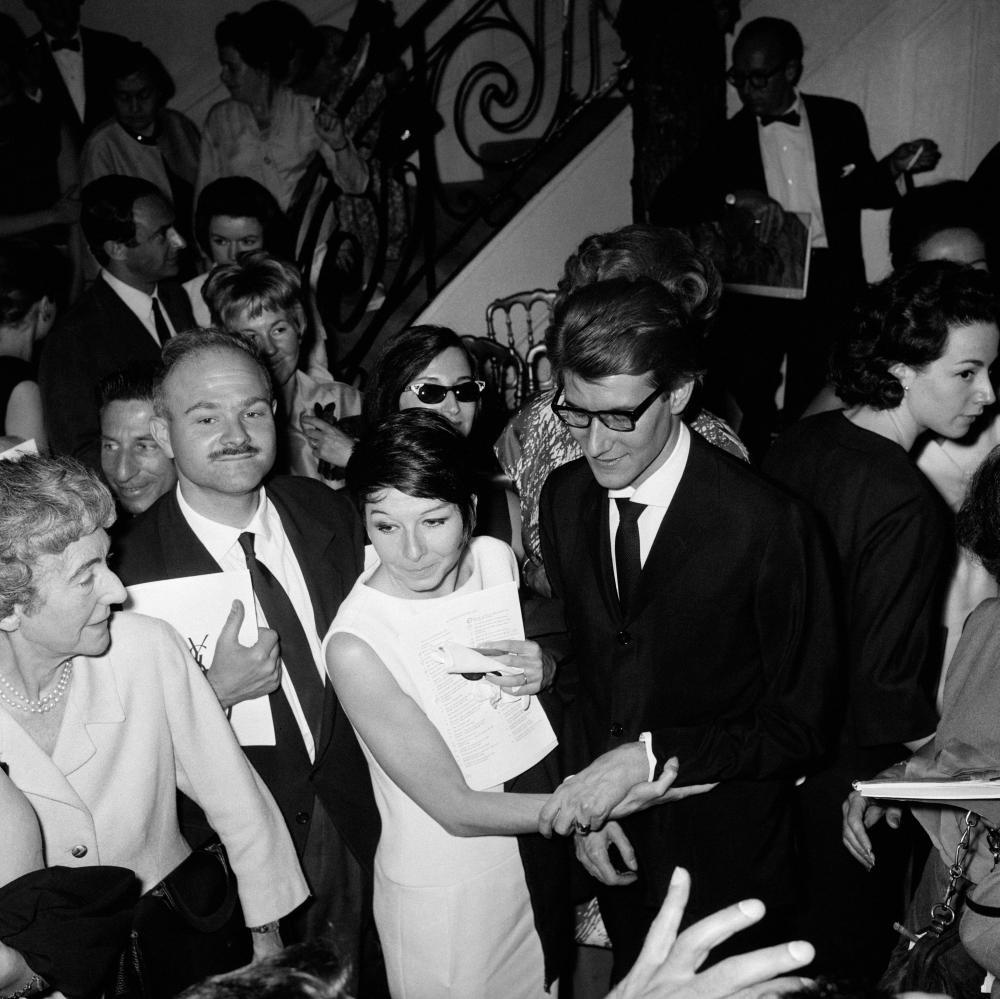 Dancer Zizi Jeanmaire congratulates designer Yves Saint Laurent after his 1963/1964 autumn/winter show.