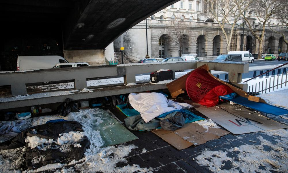 Bedding belonging to homeless people on the Embankment in London