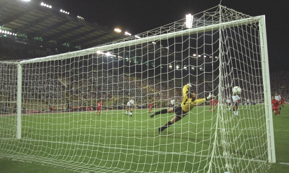 Enzo Scifo hits the outside of the post against England in Bologna.