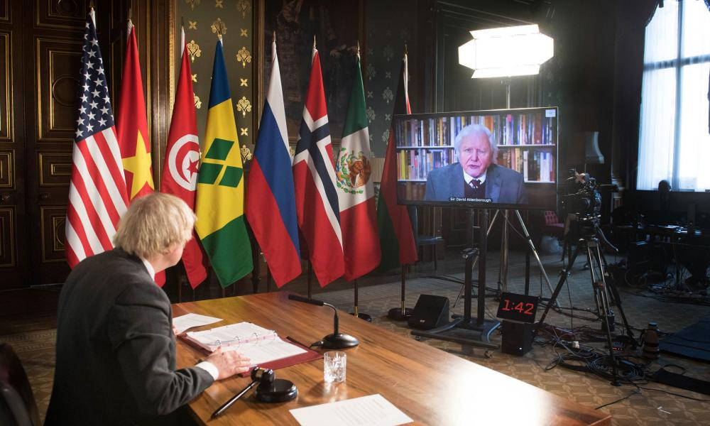 Boris Johnson watches a video address by Sir David Attenborough at a virtual session of the UN Security Council on climate and security today.