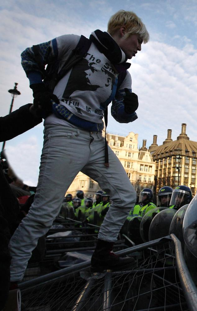 A student in a Smiths T-shirt, protesting against tuition fee rises, in Parliament Square, London, in 2010