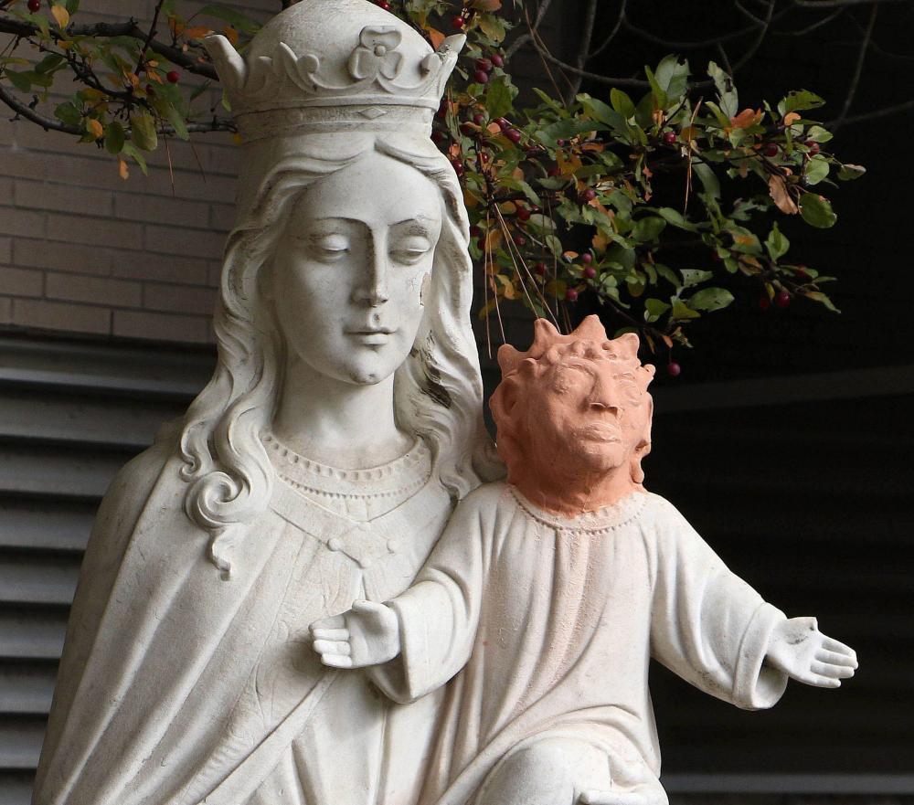 A statue stands outside Ste. Anne des Pins parish in Sudbury, Ontario
