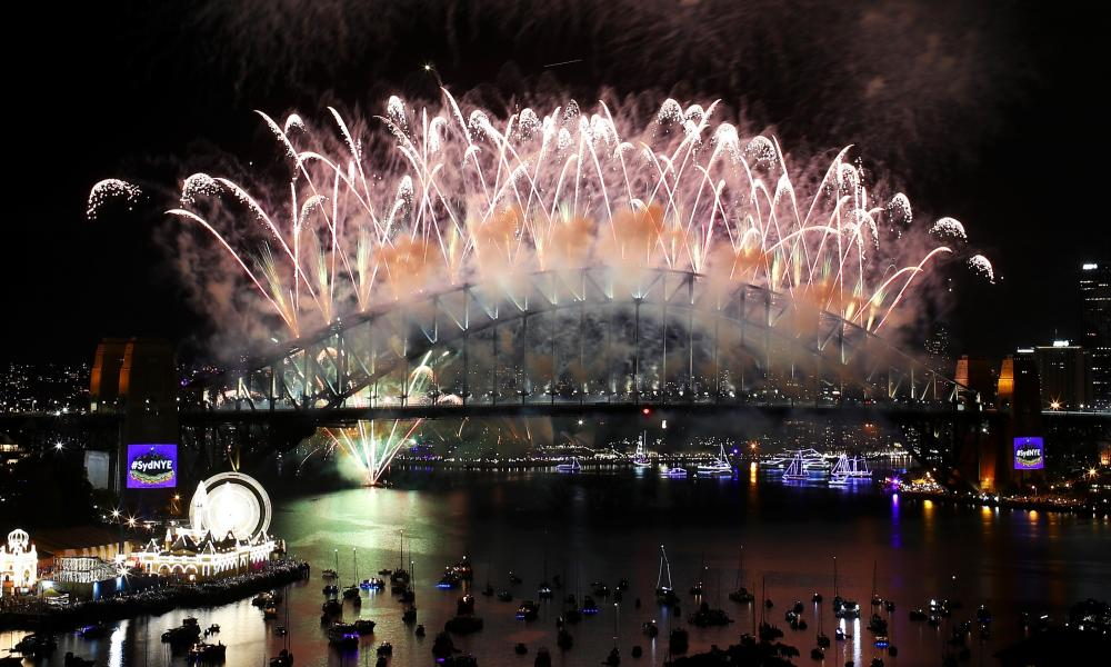 Fireworks explode off the Sydney Harbour Bridge.