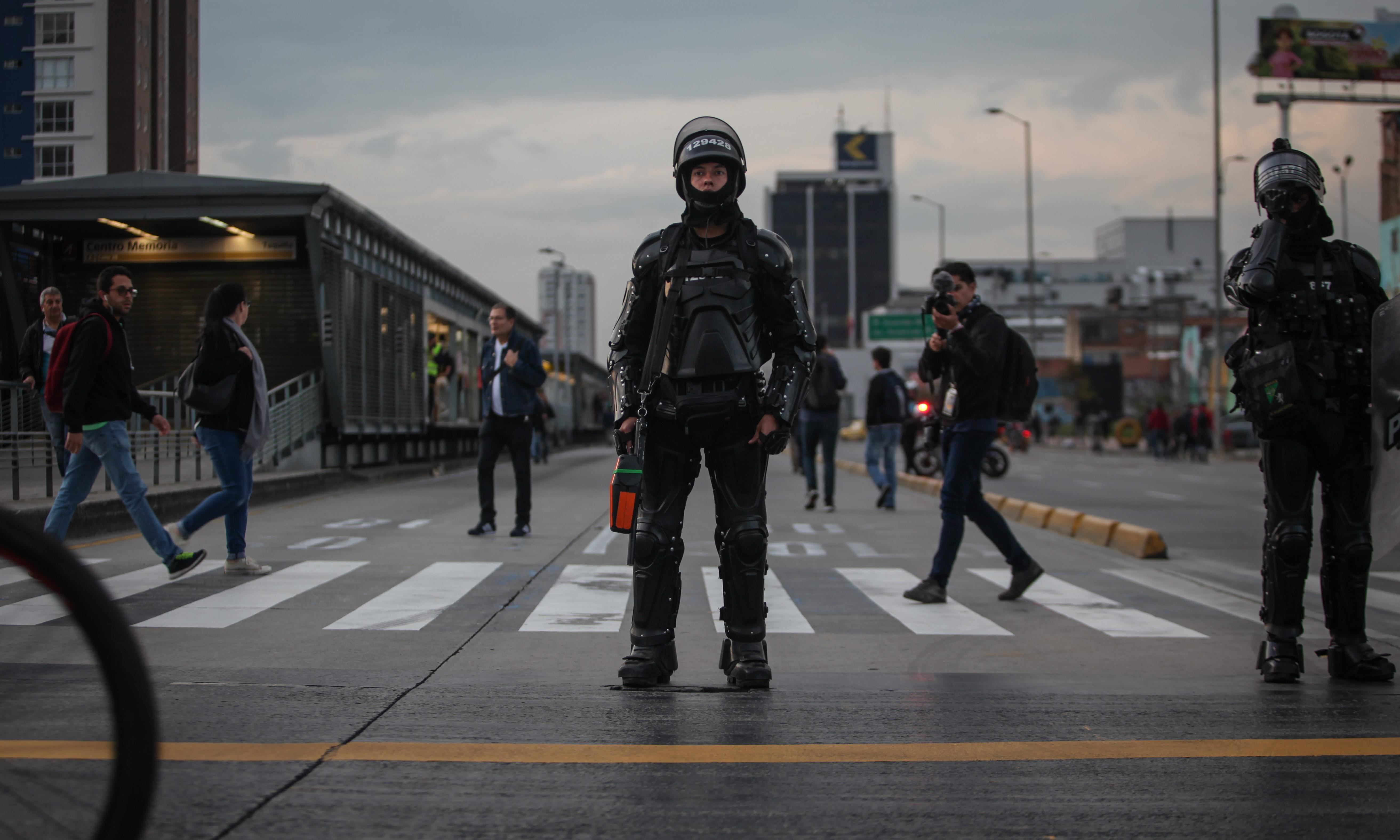 Outrage after Colombia riot police force young woman into unmarked car