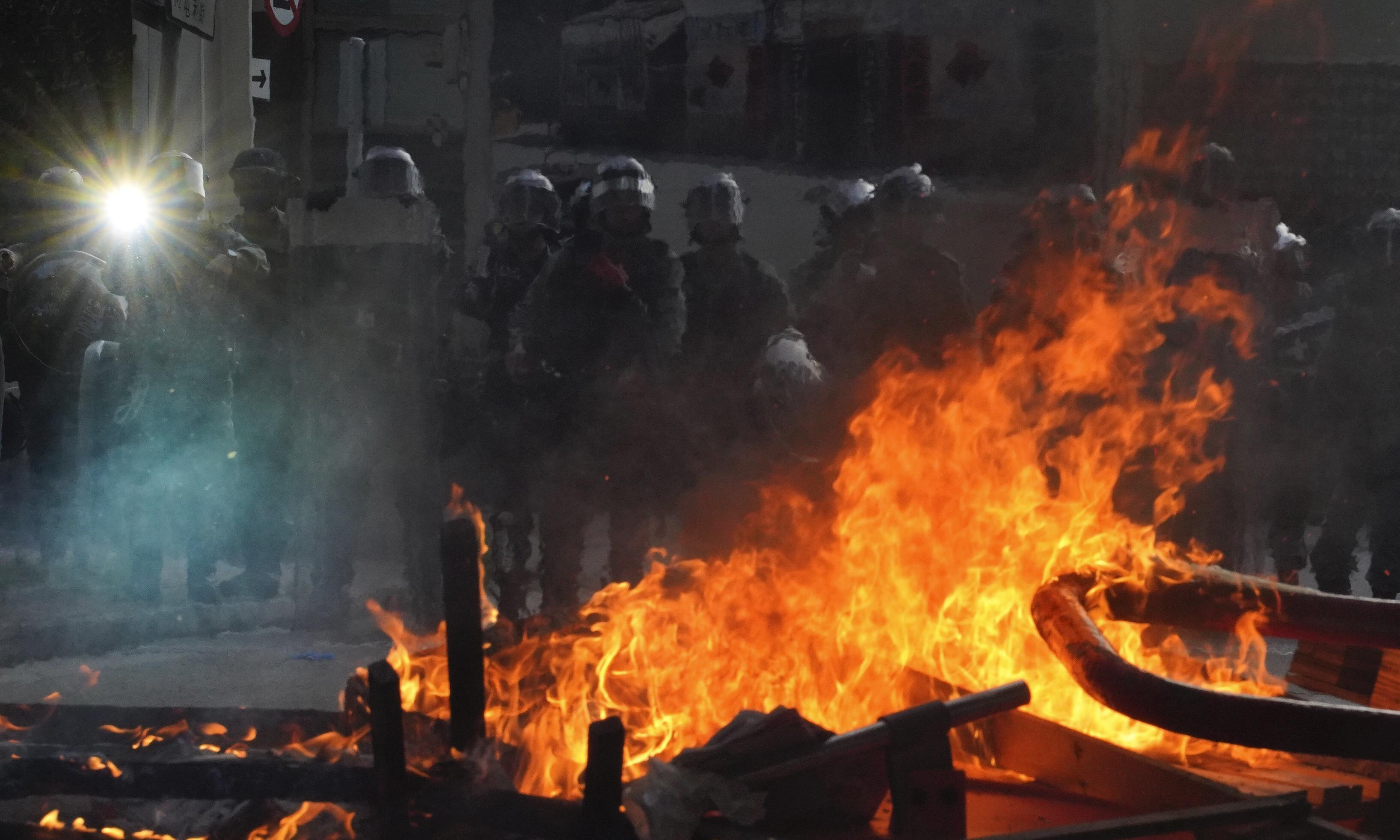Hong Kong riot police fire teargas at protesters as unrest continues