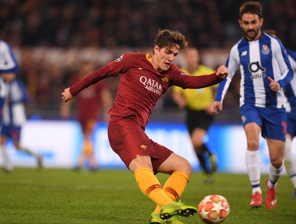 Roma's Nicolo Zaniolo drills in the opening goal.