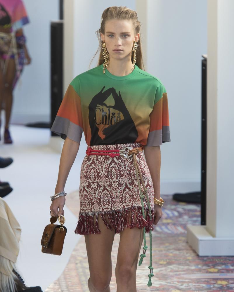 A model wears a rug fashioned into a skirt at the Chloé show.
