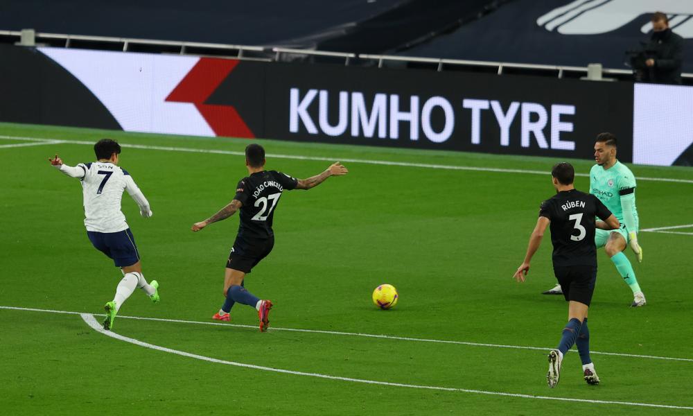 Son Heung-min of Tottenham Hotspur scores his team's first goal.