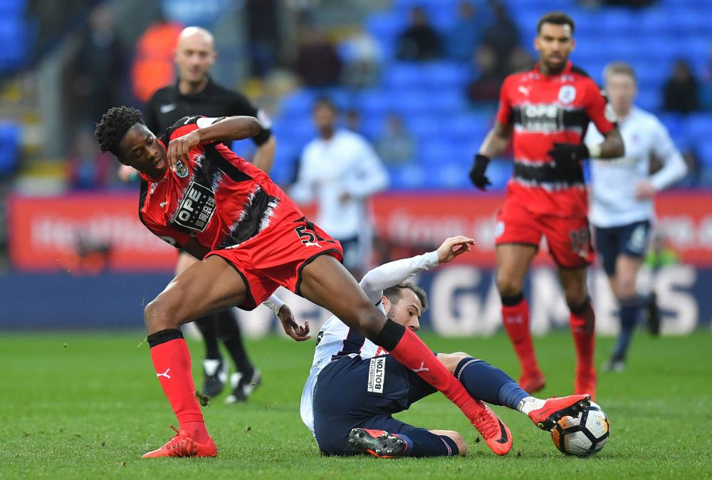 Huddersfield Town's Terence Kongolo, left, gets stuck in during the Terriers' Third Round FA Cup match against Bolton Wanderers.