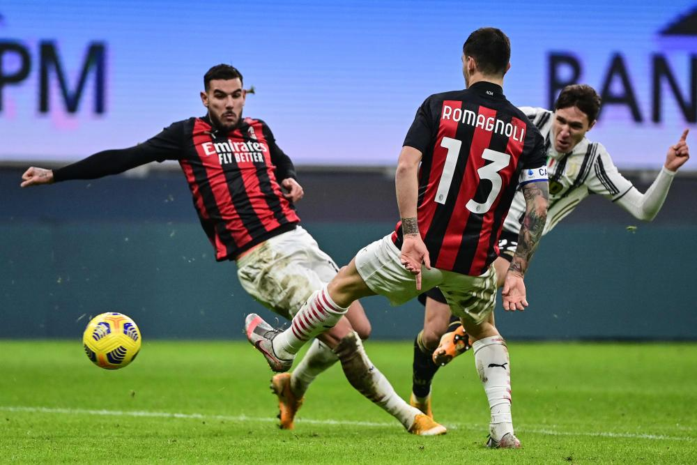 Juventus' Federico Chiesa (right) slots the ball home to give the visitors back in front.