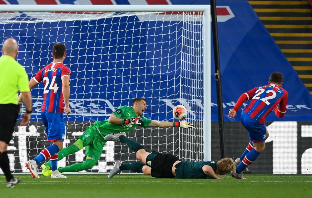 Crystal Palace's Vicente Guaita fails to stop Mee's header.