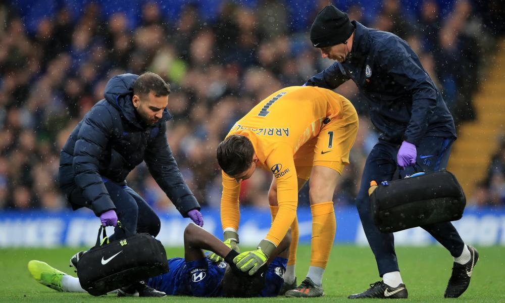 Chelsea's Kurt Zouma receives treatment from medical staff.