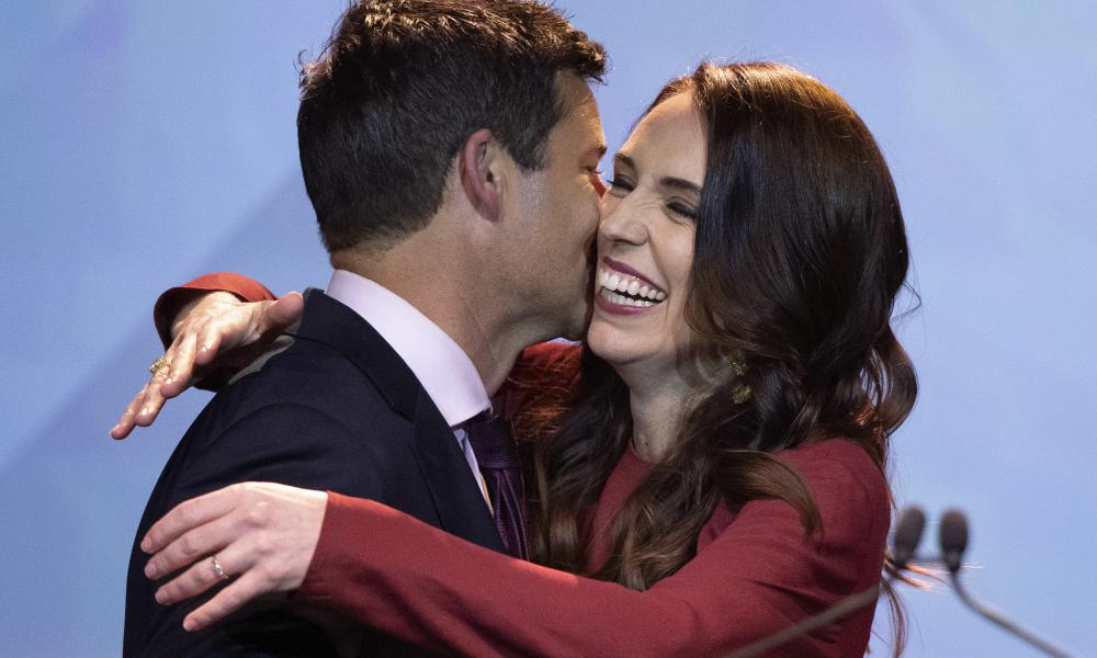 New Zealand Prime Minister Jacinda Ardern, right, is congratulated by her partner Clarke Gayford following her victory speech to Labour Party members at an event in Auckland, New Zealand, Saturday, 17 October, 2020.