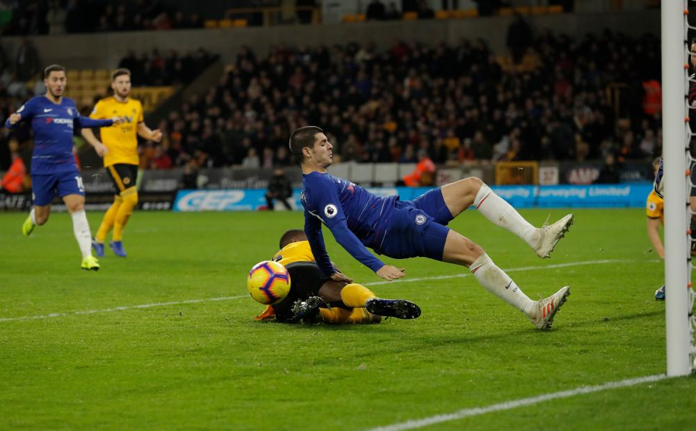 Alvaro Morata falls under a challenge by Willy Boly.