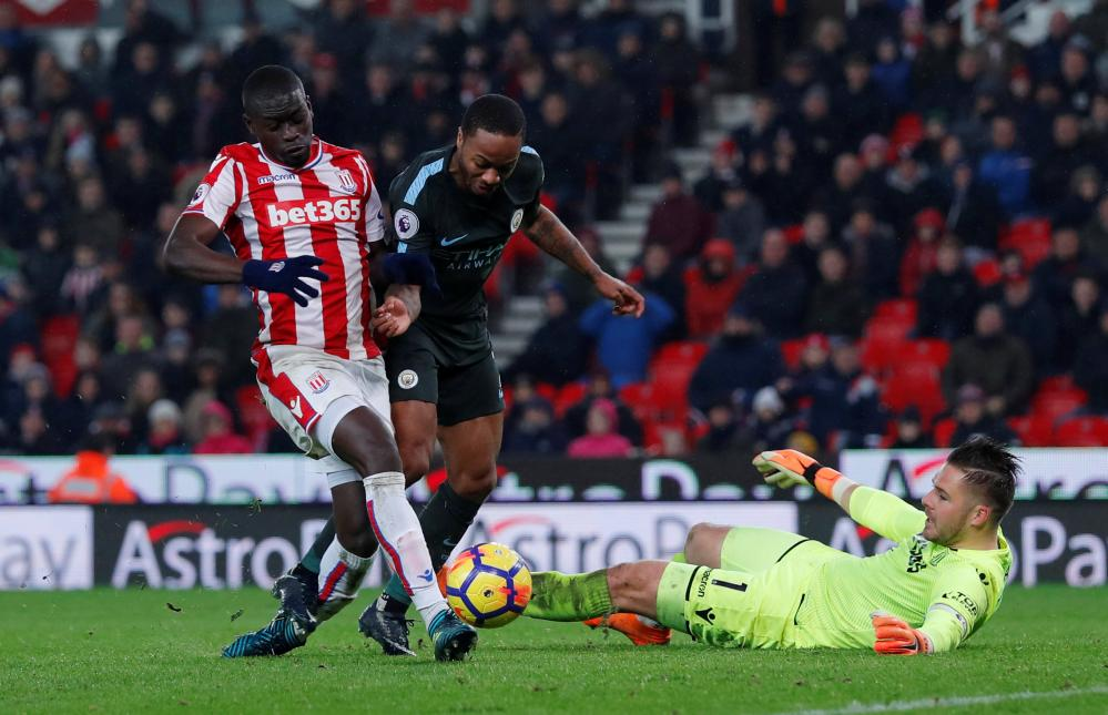 Sterling in action with Stoke City's Papa Ndiaye.