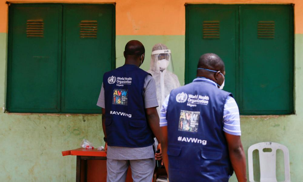 Officials of the World Health Organisation are seen during a community testing in Abuja, Nigeria 15 April, 2020.