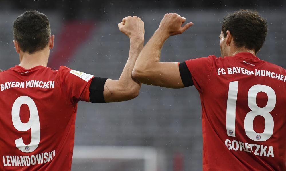 Bayern Munich's Leon Goretzka (right) celebrates scoring their first goal with Robert Lewandowski.
