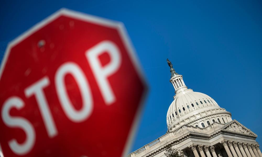 Federal workers were told to stay home after the White House and Congress failed to pass a government spending bill.